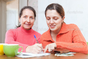 positive women fills in utility payments bills